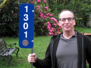 Rotary home number sign held by President-Elect Ross Patterson